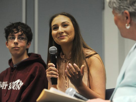 Bella Robakowski from Newbury Park High and Sam Coats from Ventura High are seated adjacent to U.S. Rep. Julia Brownley at a student town hall meeting she hosted last spring at the Ventura County Office of Education in Camarillo. The topic was gun violence.