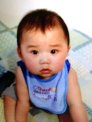 Bill Thao, 13 months old, was shot and died later Dec.