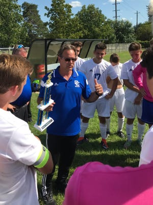 Novi Detroit Catholic Central boys soccer coach Gene Pulice congratulates his squad after winning Saturday's Gary Balconi Varsity Soccer Tournament at Plymouth-Canton Educational Park. The Shamrocks blanked Walled Lake Northern, 3-0, in the championship game.