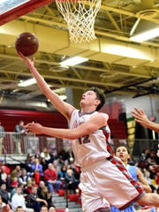 Tyler Schreck breaks his way to the basket for Dixie