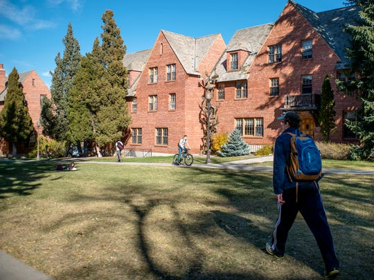 Students travel in October between classes outside of the Honors College on Montana State University campus.