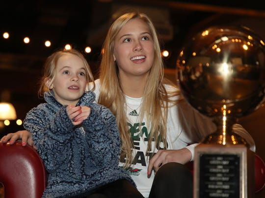 UW-Green Bay basketball player Jessica Lindstrom, right,  sits with  Adaiah Rezachek during the NCAA Women's Basketball Championship selection show party Monday, March 12, 2018 at the Green Bay Distillery in Ashwaubenon, Wis.