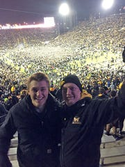 Cameron Schorg, left, is shown with his father, Gary,