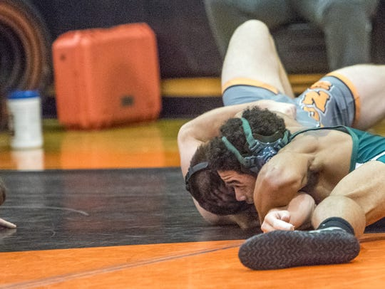 Long Branch's Louie Saez puts Middletown North's Nico