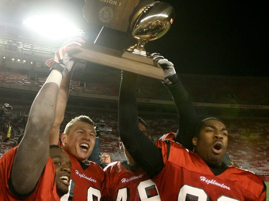 Homestead's Shelby Harris (right) lifts the Division 1 Championship trophy in 2008.