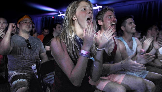 Golden State fan Em Boone cheers for her team during the NBA finals which was broadcast at Bonnaroo Cinema on Thursday June 11, 2015.
