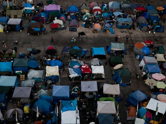 A large homeless encampment is formed in the Santa Ana Civic Center on Wednesday, Oct. 11, 2017, in Santa Ana, Calif.