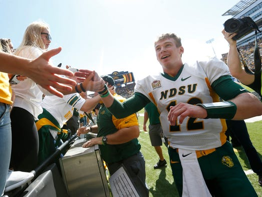 North Dakota State quarterback Easton Stick high fives