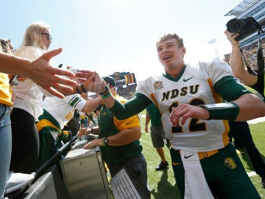 North Dakota State quarterback Easton Stick high fives