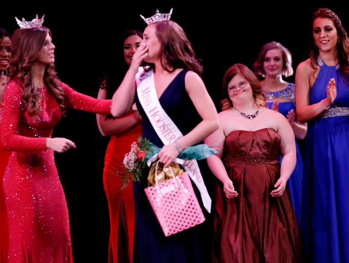 Mickey watches as pageant contestant Kyla Brummett
