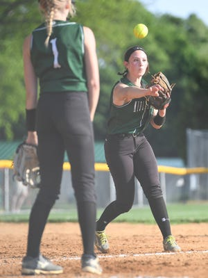 Emerson at Midland Park in the second round of the North 1, Group 1 Softball State Tournament on Wednesday, May 23, 2018. MP #14 Leah Mercadante throws to first to get the out.