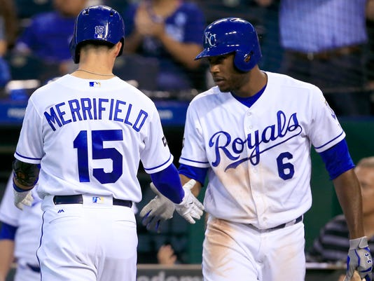 Kansas City Royals' Whit Merrifield (15) is congratulated by teammate Lorenzo Cain (6) after his solo home in the third inning of a baseball game against the Tampa Bay Rays at Kauffman Stadium in Kansas City, Mo., Tuesday, Aug. 29, 2017. (AP Photo/Orlin Wagner)