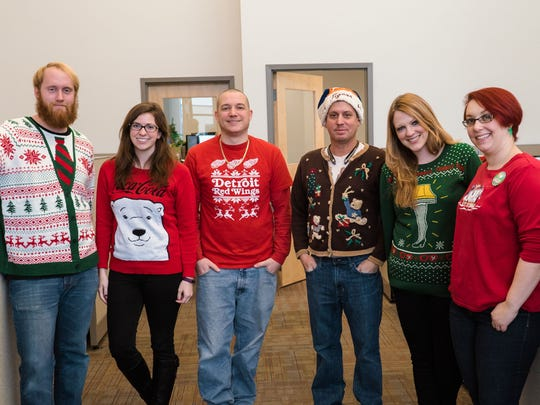 From left, Eric Howard, Megan Maher, Ryan Beals, Tony Greer and Kaylyn Patton, a former employee, during the ugly sweater competition at Service Express in December 2016.