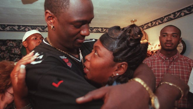 In this News-Press file photo from 1991, University of Florida defensive end and North Fort Myers High graduate Jevon Kearse hugs his mother, Lessie Green, after finding out he was drafted by the Tennessee Titans.