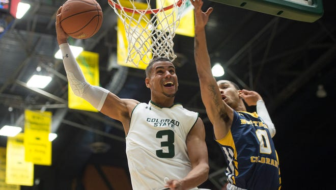 CSU guard Gian Clavell moves in for a layup under the net during a game against UNC at Moby Arena Saturday, December 10, 2016.