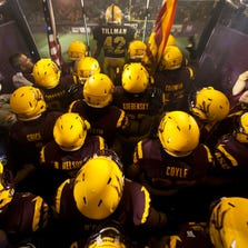 Arizona State football team prepares to take the field behind a photograph of Pat Tillman against Sacramento State at Sun Devil Stadium on Thursday, Sep. 5, 2013 in Tempe.