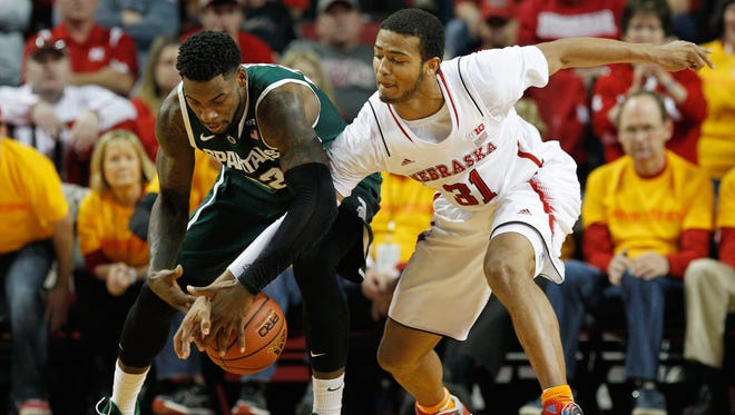 Nebraska Cornhuskers guard Shavon Shields (31) and Michigan State Spartans guard Branden Dawson (22) fight for the loose ball in the first half at Pinnacle Bank Arena.