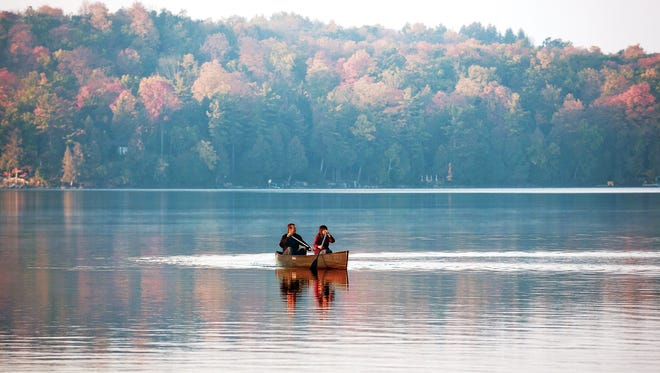 Fall colors provide a beautiful backdrop for canoeing Elkhart Lake.