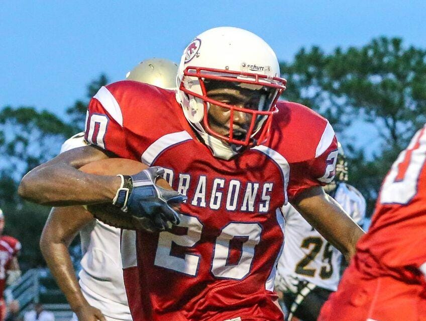 FSDB football player Ernest Bristol tries to break free on a run against Halifax Academy early in the 2015 season. The Dragons completed their 102nd season of football two weeks ago.