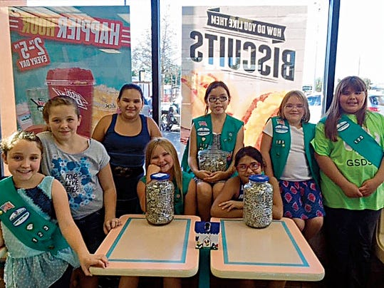 Courtesy Photo   Deming Girl Scout Junior Troop 56123 collected tabs from soda cans for a donation to the Ronald McDonald House in Albuquerque. The junior troop chose to do this project in honor and memory of former Deming Girl Scout Jacquelyn Marie Salcido. The project has become an annual tribute to their fellow Scout. The tabs were presented to Taco Bell Distric Manager Caroline Murray, at the Deming Taco Bell. From left are Sophia, Kendra, Karla, Analyssa, Miranda, Illyana, Faith and Alicia.
