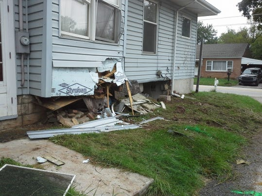 This photo shows the side of Karen Melhorn's house in the 2000 block of Church Road, West Manchester Township, where a vehicle crashed into it late Saturday night.