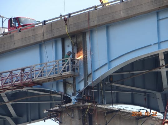 A construction worker is pictured using what appears to be a cutting torch on the Norman Wood Bridge on Thursday, Oct. 22, 2015.