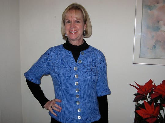 My sister-in-law, Susan Sebbard, wearing the Vine Yoke Cardigan I made her a few years ago.