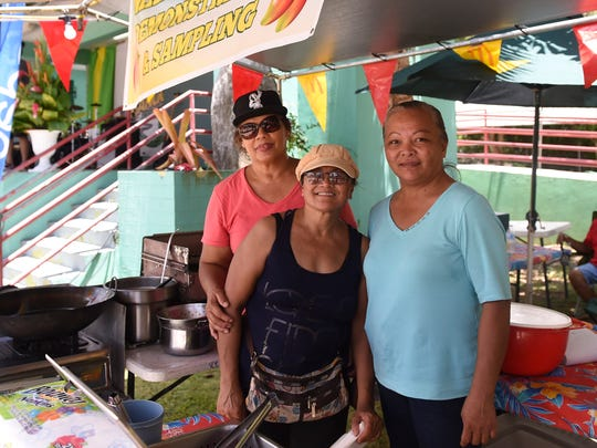Doris Chiguina, left, Linda Yatar, center, and Debbie Hernandez at their donut mango stand during the 12th annual Agat Mango Festival.  The 13th annual Agat Mango Festival opens from 6 to 10 p.m. May 24and continues from 10 a.m. to 10 p.m. May 25-26.