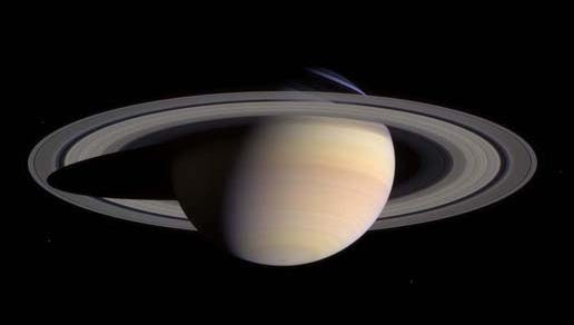 Saturn's peaceful beauty invites the Cassini spacecraft for a closer look in this natural color view, taken during the spacecraft's approach to the planet. By this point in the approach sequence, Saturn was large enough that two narrow angle camera images were required to capture an end-to-end view of the planet, its delicate rings and several of its icy moons. The composite is made entire from these two images.