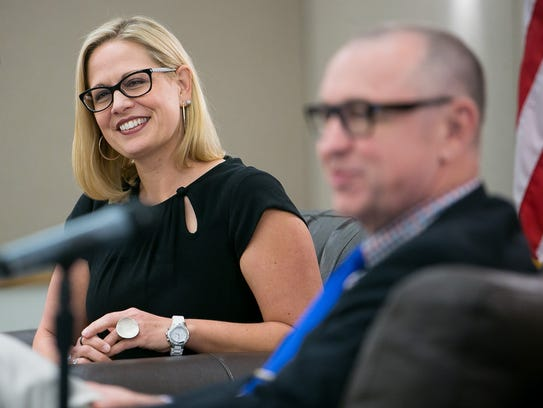 U.S. Rep. Kyrsten Sinema and former U.S. Rep. Matt
