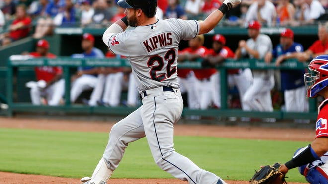 Cleveland Indians' Jason Kipnis (22) follows through on a two-run home run against the Texas Rangers during the second inning of a baseball game, Friday, July 20, 2018, in Arlington, Texas. (AP Photo/Jim Cowsert)