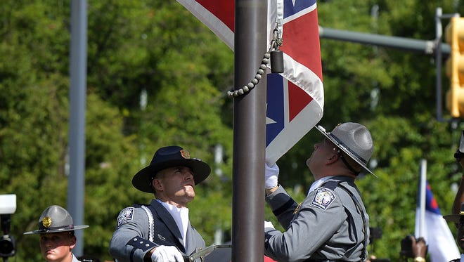 The South Carolina Highway Patrol Honor Guard removes the Confederate flag from the S.C. Statehouse grounds on Friday, July 10, 2015.