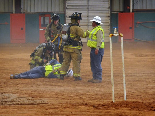"""First Responders treat a """"victim"""" during a demonstration"""