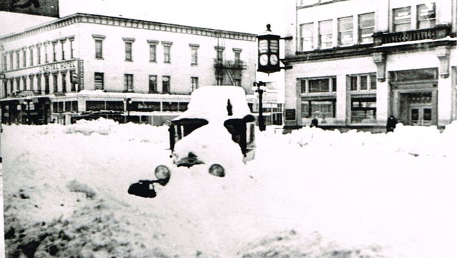Downtown Salem looking south on Commercial Street near State Street is seen covered in snow after a snowstorm on Jan. 31, 1937. 2013.013.0048 / Willamette Heritage Center