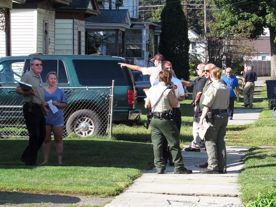 City of Elmira fire marshals, code enforcement officers and animal control personnel conduct a sweep Wednesday morning along Linden Place looking for violations.