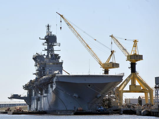 The America (LHA-6), an America class amphibious assault ship, sits at the end of the yard at Ingalls Shipbuilding in Pascagoula, Miss. as it undergoes final fittings for delivery in 2013.