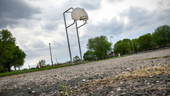 The basketball court at Northway Park is pictured Friday, May 18, in St. Cloud. The court, constructed in 1982, is one of three finalists for a Our Courts, Our Future rehab program.