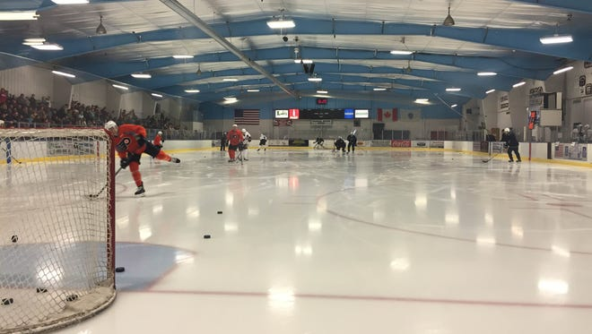 Matt Read, left, takes a shot as the Flyers practice for the first time in Orleans, Mass.