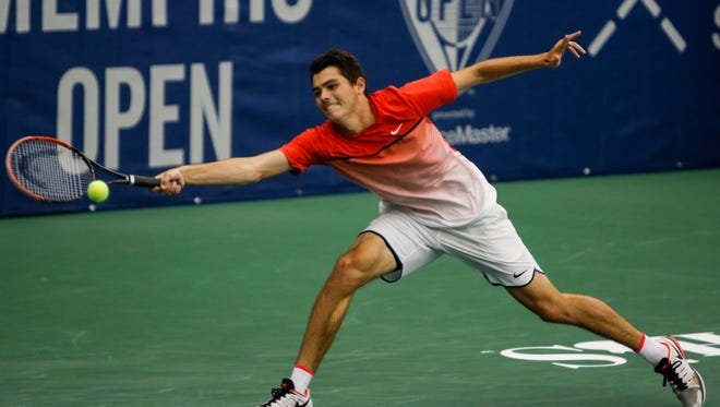 February 12, 2016 - Taylor Fritz returns the ball against Benjamin Becker during the fifth day of the Memphis Open at the Racquet Club in East Memphis on Feb. 12, 2016.