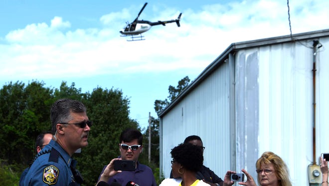 Dickson County Sheriff Jeff Bledsoe speaks to the media while a helicopter passes by searching for suspect Steven Wiggins on Thursday, May 31, 2018.  Wiggins is a suspect in the shooting death of 32-year-old Dickson County Sheriff's Office Sgt. Daniel Baker, who was found dead in his vehicle Wednesday morning.
