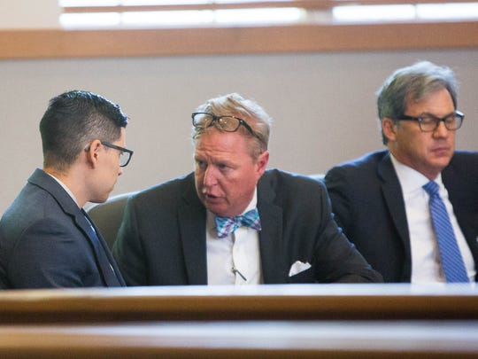 Tai Chan, left, speaks with his attorney Tom Clark, right, after jury selection in Chan's murder trial Monday May 8, 2017 in Third Judicial District Court in Las Cruces.