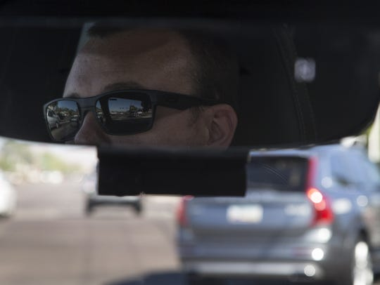 Reuban Mayne (pilot) is reflected in the rearview mirror