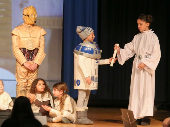 "Mai as Princess Leia Maccabeea gives the plans to the temple to 8 Nay Rote (Emma) and 2-5 Kis Lev (Noam) as Albert Einstein Academy students take part in the Hanukkah/Star Wars mashup production ""Star (of Judah) Wars"" at the Siegel JCC Thursday."