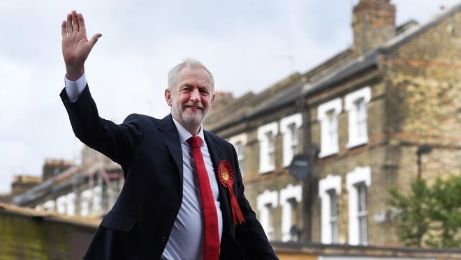 British Labour Party leader Jeremy Corbyn arrives to vote in the British general election at a polling station in Islington, north London.