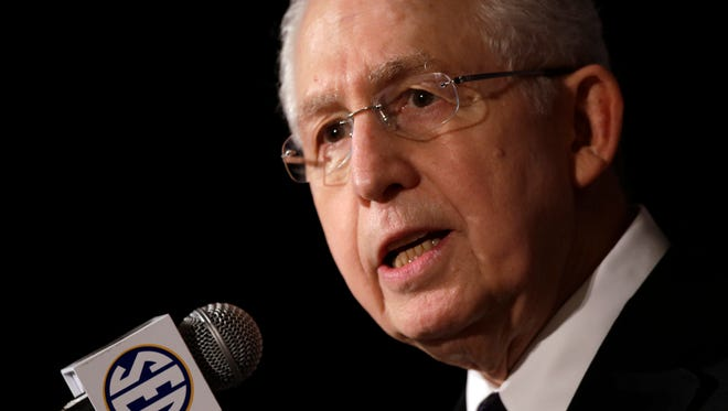 FILE - In this July 16, 2013 file photo, Southeastern Conference Commissioner Mike Slive talks with reporters during the SEC football Media Days in Hoover, Ala. Slive addresses an Associated Press Sports Editors meeting with athletes' unionization among the hot topics in college sports, Monday, April 21, 2014, in Birmingham, Ala.  (AP Photo/Dave Martin, File)