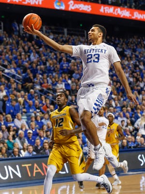 Kentucky's Jamal Murray floats a shot up after getting past Missouri's Namon Wright.  