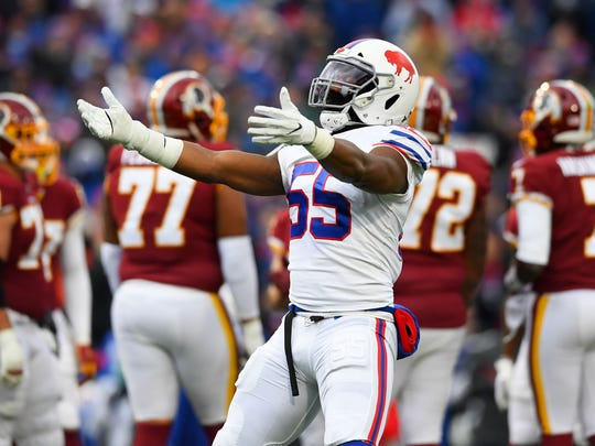 Nov 3, 2019; Orchard Park, NY, USA; Buffalo Bills defensive end Jerry Hughes (55) gestures to fans against the Washington Redskins during the second quarter at New Era Field. Mandatory Credit: Rich Barnes-USA TODAY Sports