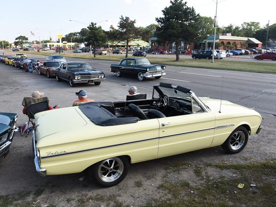Friends sit by the 1963 Ford Falcon owned by Paul Meray