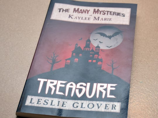 """Leslie Glover's first book, """"Treasure: The Many Mysteries"""