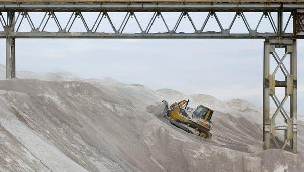 A worker moves salt around at the American Rock Salt mine in Mount Morris.